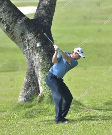 David Howell of England plays from behind a tree to the 17th green in the 3rd round of The Hong Kong Open at Fanling Golf Club on Saturday 10th December 2016.