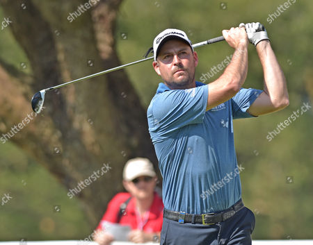 David Howell of England plays off the 18th tee in the 3rd round of The Hong Kong Open at Fanling Golf Club on Saturday 10th December 2016.