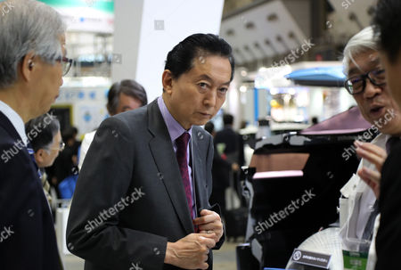 "Former Japanese Prime Minister Yukio Hatoyama inspects automaker Honda Motor's fuel cell vehicle ""Clarity Fuel Cell"" at the ""Eco Pro 2016"" an environment exhibition in Tokyo on Thursday, December 8, 2016. Some 700 private companies, local governments, NGOs, displayed their latest technology and products in the annual three-day exhibition."
