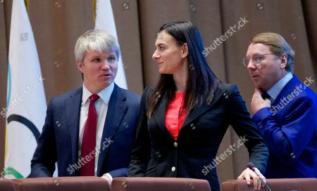 Pavel Kolobkov, Yelena Isinbayeva, Vladimir Kozhin From left, Russia's Sports Minister Pavel Kolobkov, former pole vaulter Yelena Isinbayeva and Russian Olympic Committee vice-president Vladimir Kozhin arrive for the annual meeting in Moscow, Russia, on . The Russian Olympic Committee, including representatives of all Russian sporting federations, holds its meeting annually