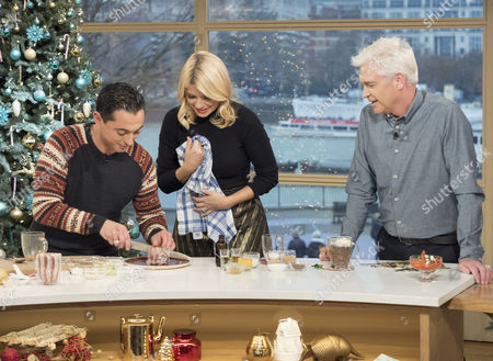 Stock Photo of Phillip Schofield and Holly Willoughby with Theo Michaels