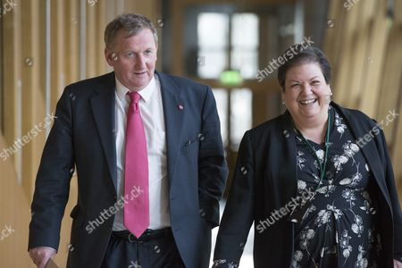 Alex Rowley, Deputy Leader of the Scottish Labour Party, and Jackie Baillie make their way to the Debating Chamber
