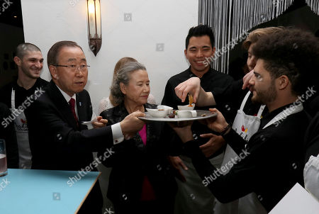 Ban Ki-moon, Yoo Soon-taek United Nations Secretary-General Ban Ki-moon and his wife Yoo Soon-taek, from left, serve the staff of a restaurant served by migrants in Vienna, Austria