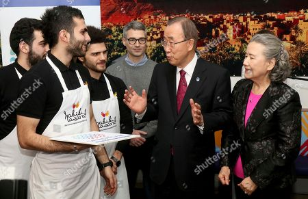 Ban Ki-moon, Yoo Soon-taek United Nations Secretary-General Ban Ki-moon, center, and his wife Yoo Soon-taek, right, talk with the staff of a restaurant served by migrants in Vienna, Austria