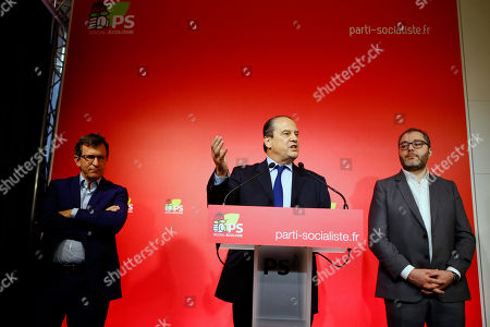 French Socialist party (PS) first secretary Jean-Christophe Cambadelis, center, flanked with party executives Christophe Borgel, left, and Rachid Temal, right, delivers his speech during a press conference about presidential primary for the upcoming 2017 presidential elections, in Paris