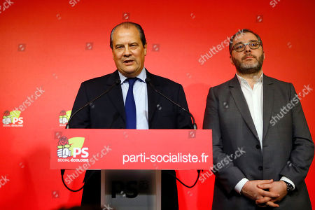 French Socialist party (PS) first secretary Jean-Christophe Cambadelis, left, flanked with party executive Rachid Temal, right, delivers his speech during a press conference about presidential primary for the upcoming 2017 presidential elections, in Paris