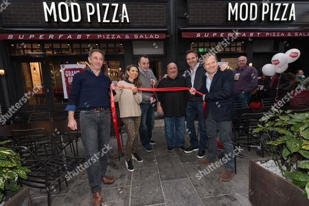 (L to R) Roger Taylor (venture partner), Ally Svenson (co-owner of MOD Pizza), John Nelson (UK CEO), Chris Schultz US operations manager), Scott Svenson (co-owner of MOD Pizza) and Sir Charles Dunstone (joint venture partner) at the opening of the MOD pizza parlour in Leicester Square.