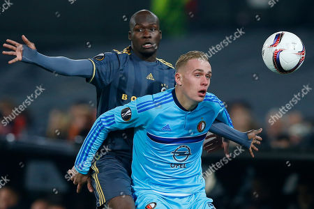 Feyenoord's Rick Karsdorp, front, blocks Fenerbahce's Moussa Sow during the Group A Europa League soccer match between Feyenoord and Fenerbahce at De Kuip stadium in Rotterdam