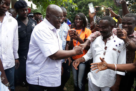 Nana Akufo-Addo, opposition presidential candidate for the New Patriotic Party, greets supporters in Accra Ghana, . The election is largely between two veteran politicians, incumbent President John Dramani Mahama and main opposition leader Nana Akufo-Addo