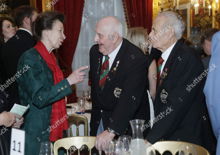 Princess Anne with Royal Tank Regiment veterans Ray Bebbington (centre), 83, and Ken Alford, 84, during a Christmas Party at St James's Palace, London for The Not Forgotten Association - a national tri-service charity which provides entertainment, leisure and recreation for the serving wounded, injured or sick and for ex-service men and women with disabilities