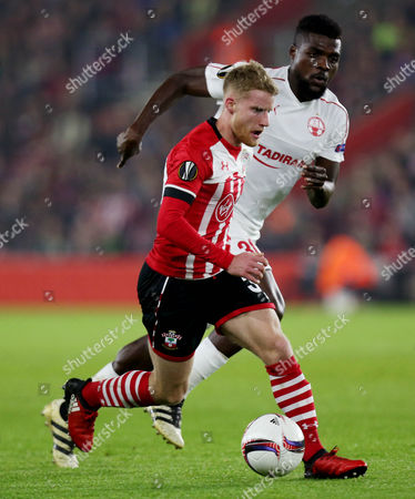 Josh Sims of Southampton and John Ogu of Hapoel Beer Sheva during the UEFA Europa League Group K match between Southampton and Hapoel Beer Sheva played at St Mary's Stadium, Southampton on 8th December 2016