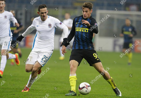 Inter Milan's Andrea Pinamonti, right, and Sparta Prague's Mario Olek vie for the ball during an Europa League Group K soccer match between Inter Milan and Sparta Prague, at the San Siro stadium in Milan, Italy