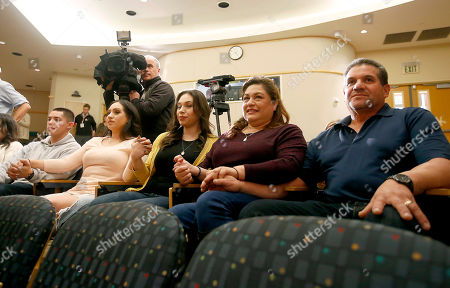 """Emilio Sandoval, Aniza Sandoval, Esmerelda Sandoval, Aida Sandoval, Arturo Sandoval From left to right; The Sandoval family, brother Emilio, sister Aniza, sister Esmerelda, mother Aida, and father Arturo hold hands during a news conference about the surgery on conjoined twins Erika and Eva Sandoval, at the Lucile Packard Children's Hospital, in Palo Alto, Calif. The conjoined twins have become two separate toddlers following a marathon surgery and are recovering """"quite well,"""" officials said Thursday"""