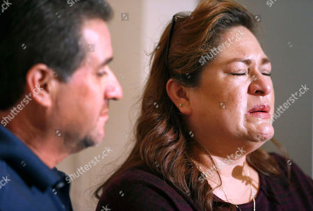 """Aida Sandoval, Arturo Sandoval Aida Sandoval, right, holds back tears as she and her husband Arturo Sandoval, addresses the media following surgery on their twin daughters at the Lucile Packard Children's Hospital, in Palo Alto, Calif. Conjoined California twins Eva and Erika Sandoval have become two separate toddlers following a 17-hour marathon surgery and are recovering """"quite well,"""" officials said Thursday"""
