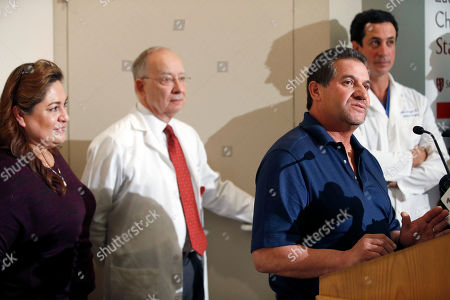 """Gary Hartman, Matias Bruzoni, Arturo Sandoval, Aida Sandoval Arturo Sandoval, and his wife Aida, left, speaks with the media as pediatric surgeon Gary Hartma, second from left, and Matias Bruzoni, right, look on at the Lucile Packard Children's Hospital, in Palo Alto, Calif. Conjoined California twins Eva and Erika Sandoval have become two separate toddlers following a marathon surgery and are recovering """"quite well,"""" officials said Thursday"""