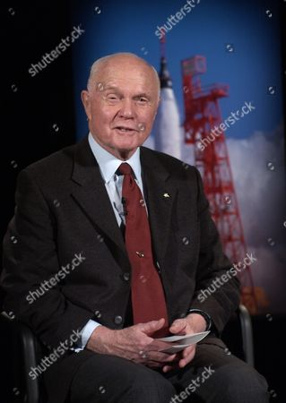 Former United States Senator John H. Glenn, Jr. (Democrat of Ohio) talks by satellite to the crew on board the International Space Station at NASA headquarters in Washington, DC. Glenn stopped by NASA to commemorate the 40th anniversary of his historic Mercury orbital flight. On February 20, 1962, Glenn became the first American to orbit the Earth, hurtling around the globe three times in a flight that lasted nearly five hours..Mandatory