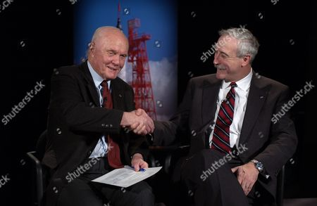Former United States Senator John H. Glenn, Jr., left, shakes hands with NASA Administrator Sean O''Keefe at NASA headquarters in Washington, DC. Glenn stopped by NASA to commemorate the 40th anniversary of his historic Project Mercury orbital flight. On February 20, 1962, Glenn became the first American to orbit the Earth, hurtling around the globe three times in a flight that lasted nearly five hours..Mandatory