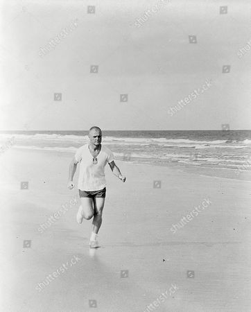 Astronaut John H. Glenn Jr., pilot of the Mercury-Atlas 6 mission, participates in a strict physical training program, as he exemplifies by frequent running. Photo taken in 1962..
