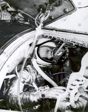 Astronaut John H. Glenn, Jr., undergoes a simulated orbital flight as part of his training for Project Mercury in the Manned Spacecraft Center's procedure trainer at Langley Air Force Base, Virginia..