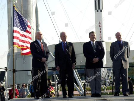During opening ceremonies for the 40th anniversary celebration of American spaceflight, four space pioneers stand at attention: (from left) John H Glenn Jr., Scott Carpenter, Wallly Schirra and Gordon Cooper. The site is the Rocket Garden in the KSC Visitor Complex At Cape Canaveral. Florida.