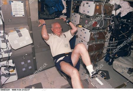 United States Senator John H. Glenn Jr. (Democrat of Ohio), payload specialist, STS95, works out on the ergometer device onboard Discovery. The photograph was taken with an electronic still camera (ESC) at 21:52:07 GMT,..