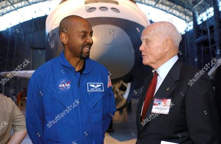 Former astronaut and United States Senator John H. Glenn Jr. (Democrat of Ohio, retired) talks with Robert L. (Bobby) Satcher Jr. of NASA's 2004 astronaut class, with the Space Shuttle Enterprise in the background during the Space Day activities at the National Air and Space Museum's Steven F. Udvar-Hazy Center in Chantilly, Virginia.Mandatory
