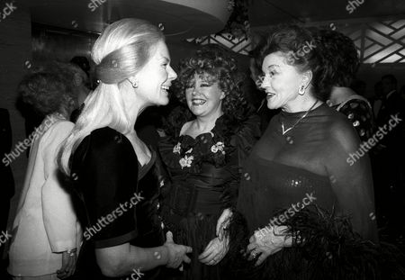 Evening Standard Film Awards the Duchess of Kent Katharine Windsor with Olivia De Havilland Lady Patricia Rothermere in the Background