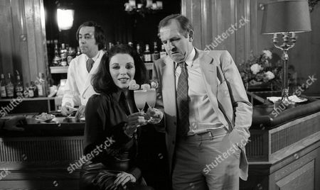 Stock Image of Filming of Cinzano/martini Advert at the Dorchester Hotel Joan Collins and Leonard Rossiter
