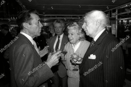 Foyles Lunch at the Dorchester Hotel Dirk Bogarde with Vivian Ellis His Sister and Dick Francis in Background