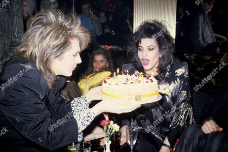 Julie Anne Friedman (rhodes) Birthday Party Julie Anne Blows out the Candles On Her Cake Held by Nick Rhodes