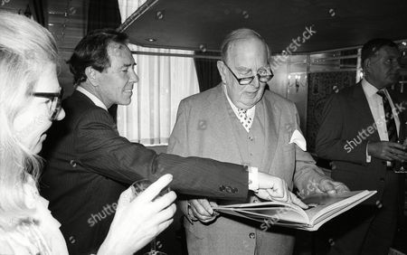 Reception For the Publication of Lord Anthony Snowdon's Book 'Stills' at the Dorchester Hotel Lord Anthony Snowdon Shows Robert Morley where He Appears in the Book