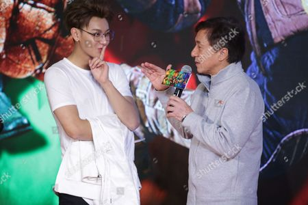 Stock Image of Jackie Chan, right, and Chinese singer and actor Huang Zitao