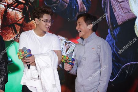 Stock Picture of Jackie Chan, right, and Chinese singer and actor Huang Zitao
