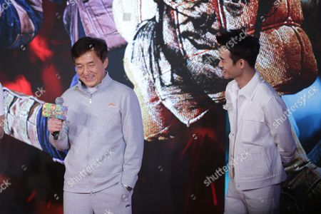 Stock Photo of Jackie Chan, right, and Chinese singer and actor Huang Zitao