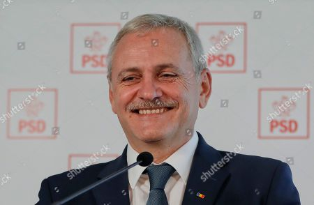 In this picture Liviu Dragnea, the leader of the Social Democratic party smiles during a press conference in Bucharest, Romania. Romanians will vote in parliamentary elections on Dec. 11, a year after a massive anti-corruption drive forced its last prime minister Victor Ponta from power, media moguls were imprisoned and one of the leaders of the second biggest party quit over a graft probe