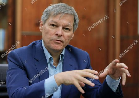 Romanian Premier Dacian Ciolos gestures during an interview with the Associated Press in Bucharest, Romania, . Romanians will vote in parliamentary elections on Dec. 11, a year after a massive anti-corruption drive forced its last prime minister Victor Ponta from power, media moguls were imprisoned and one of the leaders of the second biggest party quit over a graft probe