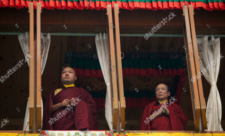 Tibetan spiritual leader, the 17th Karmapa, Ogyen Trinley Dorje, left, stands next to an important teacher of his lineage, Tai Situpa, as they watch a dance drama called 'cham' at the Sherabling monastery, about 70 kilometers (40 miles) south of Dharmsala, India, . These traditional dances are performed to celebrate the life of the 8th century Indian seer Padmasambhava, who is revered by Tibetans for his role in spreading Buddhism in Tibet