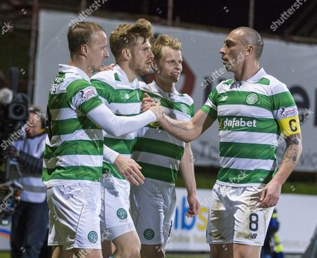 Leigh Griffiths, Stuart Armstrong, Gary Mackay-Steven & Scott Brown of Celtic celebrate after Armstrong scored their first goal during the SPFL Ladbrokes Premiership match between Partick Thistle & Celtic at Firhill, Glasgow on 9th December