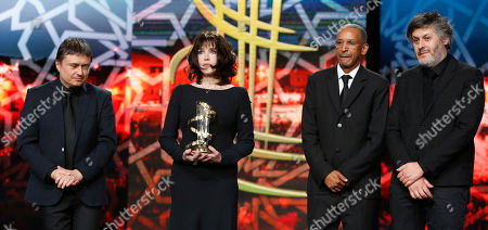 Director Cristian Mungiu, left, French actress Isabelle Adjani, Director Christophe Honore and Mauretanian director Abderrahmane Sissako pose for photographers during a tribute to Adjani contribution to acting, during the 16th Marrakech International Film Festival in Marrakech, Morocco