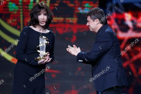 Isabelle Adjani, Cristian Mungiu Director Cristian Mungiu, right, applauds French actress Isabelle Adjani after she received a tribute to her contribution to acting, during the 16th Marrakech International Film Festival in Marrakech, Morocco