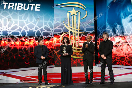 Cristian Mungiu, sabelle Adjani, Christophe Honore, Mauretanian director Abderrahmane Sissako From left, director Cristian Mungiu, left, French actress Isabelle Adjani, director Christophe Honore and Mauretanian director Abderrahmane Sissako pose for photographers during the 16th Marrakech International Film Festival in Marrakech, Morocco, . Adjani received a tribute to her contribution to acting