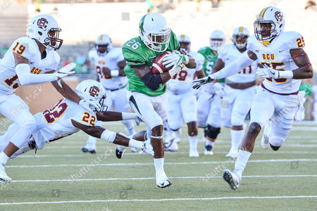 th, .North Texas Mean Green running back Jeffrey Wilson (26) rushes in for a touchdown as he eludes Bethune Cookman Wildcats safety Diquan Richardson (22) and .Bethune Cookman Wildcats defensive back Arthur Williams (25) during an NCAA College football game between the Bethune-Cookman Wildcats and the North Texas Mean Green at Apogee Stadium in Denton, Texas