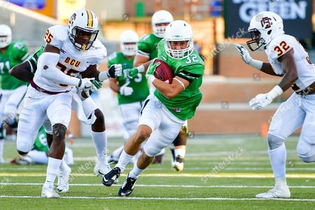 th, .North Texas Mean Green wide receiver Michael Lawrence (32) carries the ball as Bethune Cookman Wildcats defensive back Arthur Williams (25) gives chase during an NCAA College football game between the Bethune-Cookman Wildcats and the North Texas Mean Green at Apogee Stadium in Denton, Texas