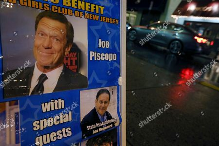 Photographs of actor, comedian and radio host Joe Piscopo and New Jersey Assembly Republican Leader Jon Bramnick, R-Union, N.J., are seen on a sign promoting a comedy event to help raise funds for the Boys and Girls Club of America at the Stress Factory Comedy Club, in New Brunswick, N.J. Famous for his SNL portrayal of Frank Sinatra, the actor, comedian and radio host is a potential candidate for governor in 2017 to succeed Republican Gov. Chris Christie