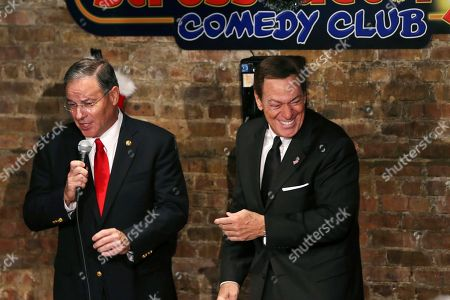 Jon Bramnick, Joe Piscopo Actor, comedian and radio host Joe Piscopo, right, laughs as New Jersey Assembly Republican Leader Jon Bramnick, R-Union, N.J., makes a joke, while they stand together on stage during a comedy event to help raise funds for the Boys and Girls Club of America at the Stress Factory Comedy Club, in New Brunswick, N.J. Piscopo is serious when he says he's considering a run for New Jersey governor in 2017. He says he's been meeting with Republican county officials and lawmakers to feel out his prospects