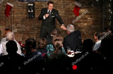 Actor, comedian and radio host Joe Piscopo fist bumps with a fan as he does a comedy routine during an event to help raise funds for the Boys and Girls Club of America at the Stress Factory Comedy Club, in New Brunswick, N.J. Piscopo is serious when he says he's considering a run for New Jersey governor in 2017. He says he's been meeting with Republican county officials and lawmakers to feel out his prospects