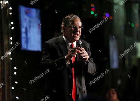 """New Jersey Assembly Republican Leader Jon Bramnick, left, R-Union, N.J., stands on stage as he performs a comedy routine during an event to help raise funds for the Boys and Girls Club of America at the Stress Factory Comedy Club, in New Brunswick, N.J. At comedy events, Bramnick bills himself as, the """"funniest lawyer in New Jersey"""". Also performing was actor, comedian and radio host Joe Piscopo, who says he's considering a run for New Jersey governor in 2017"""