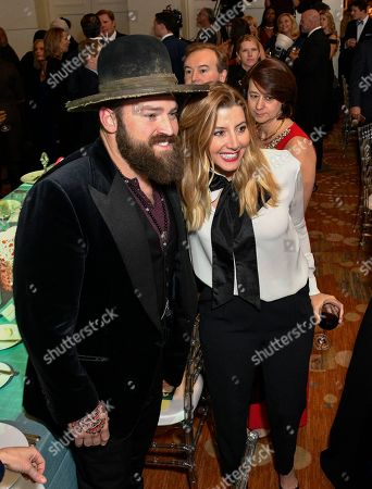 """Zac Brown, Sara Blakely Singer Zac Brown and Spanx founder Sara Blakely, right, pose for a photo together during the Captain Planet Foundation's 25th Anniversary Benefit Gala, in Atlanta. Based on the critically acclaimed animated TV series """"Captain Planet and the Planeteers,"""" the foundation was co-founded in 1991 by media mogul Ted Turner and producer Barbara Pyle and since then has played a critical role in helping to ensure that the next generation of business leaders and policy makers are environmentally literate citizens who leverage technology and information to manage and protect the land, air and water"""