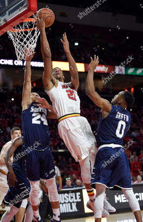 Justin Jackson, Quinn Taylor, Nick Griffin Maryland forward Justin Jackson (21) goes to the basket against St. Peter's guard Quinn Taylor (24) and St. Peter's guard Nick Griffin (0) during the second half of an NCAA college basketball game, in College Park, Md. Jackson was fouled on the play. Maryland won 66-56