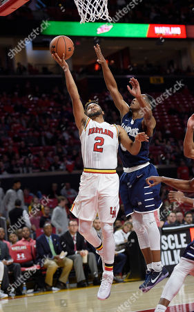 Melo Trimble, Nick Griffin Maryland guard Melo Trimble (2) goes to the basket against St. Peter's guard Nick Griffin, right, during the second half of an NCAA college basketball game, in College Park, Md. Maryland won 66-56